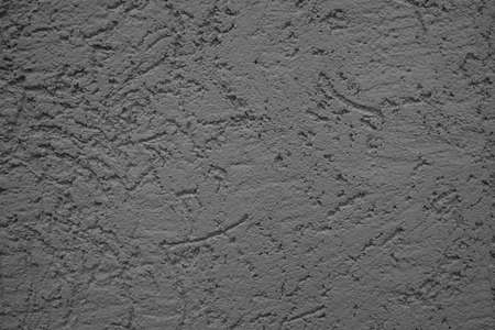 The wall is made of plaster with scratches. Rough surface. abstract gray background. A template for the design of a website or ad. 免版税图像