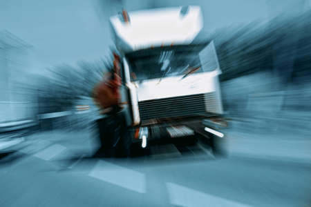 Truck in a blur on the road in motion. The danger of a collision or emergency situation. Violation of rules by truckers. The concept of vigilance at the wheel 免版税图像 - 159313908