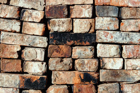 folded old red brick background. The old building material is stacked. Abstract texture background