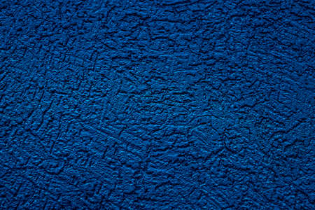 The wall is made of plaster with scratches. Rough surface. abstract blue background. A template for the design of a website or ad.