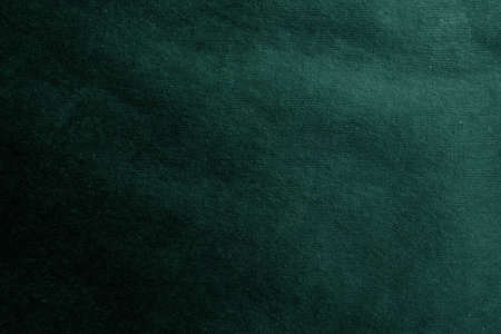 Abstract background made of rough craft paper. Blank surface for a design dark green color