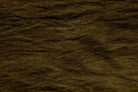 Blank surface of rough, crumpled burlap. Abstract background of dark color from a textile material. Top view