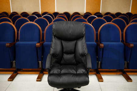 There are many chairs in a row in the Assembly hall. Meeting or conference room.