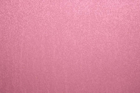 Abstract pink background. An empty, flat surface with a fine texture.