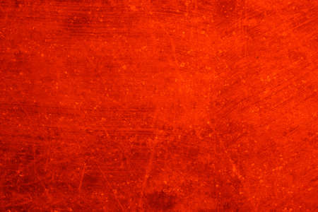 Abstract background of orange color. An empty, flat surface with a fine texture.