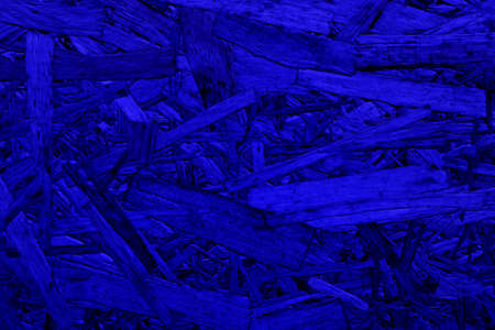 Abstract blue background. An empty, flat surface with a fine texture.