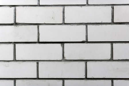 Abstract background. White brick wall close-up.