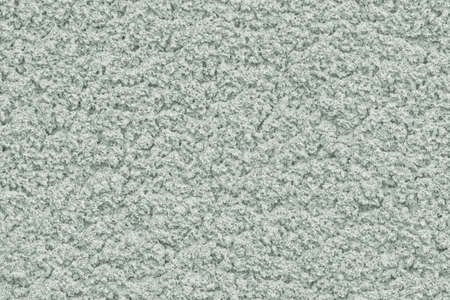Solid background of soft pastel color with rough plaster texture. 免版税图像