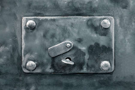 Internal lock of the safe close-up. A brutal metal savings box. The concept of reliable protection of deposits 免版税图像