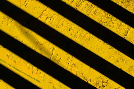Yellow background with black diagonal stripes. 免版税图像