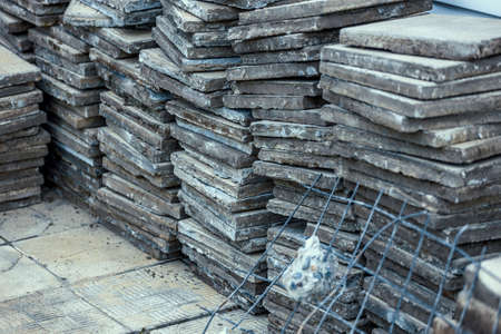 Used paving slabs have been dismantled and stacked. 免版税图像