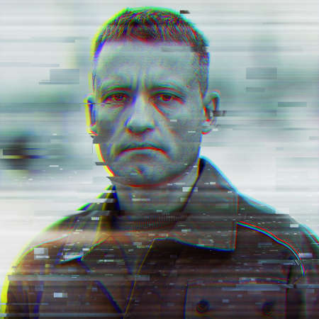 Portrait of a serious and tired worker with a glitch effect. Cybernization of the workforce. 免版税图像