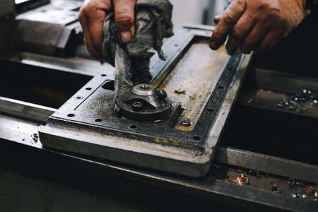 Service and repair of machine tools in a machine shop or workshop.