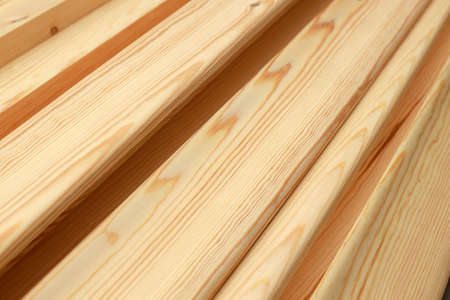 Polished wooden boards close-up. This is a smooth noble wood in full screen.