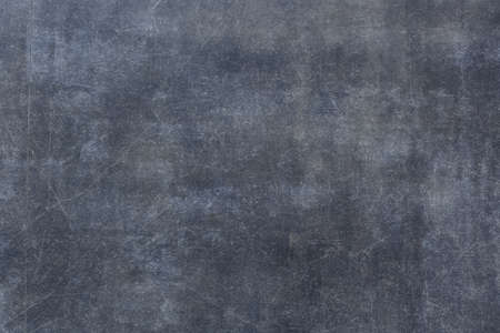 Blank gray surface with scratches and aged effect. Neutral background for placing information with a matte texture. 免版税图像