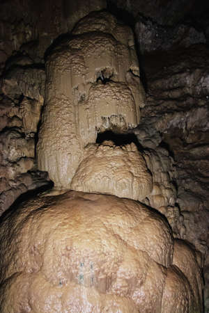 Human image of stalagmites and stalactites in the New Athos cave in Abkhazia. A popular place for tourists to visit.