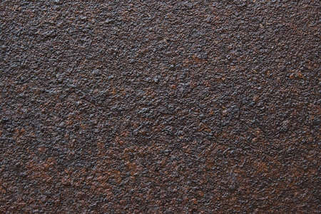 Its an old, rusty, dark-colored metal surface. Abstract background with texture on the corrosion of metals. 免版税图像