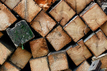 This is chopped wood laid in a woodpile. Preparation of fuel for the winter period for heating.
