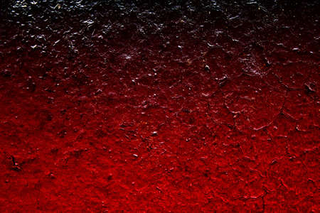 Abstract red background with gradient and darkening.