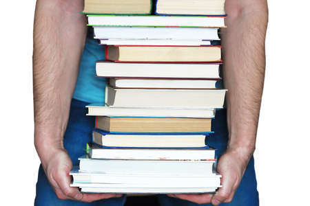 It is a stack of books in a mans hands, isolated on a white background. The concept of education