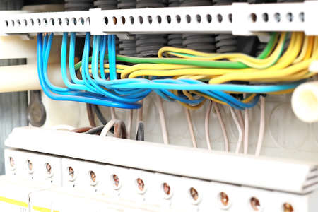 This is a clean electrical shield with the correct wiring of the new wires in close-up. 免版税图像