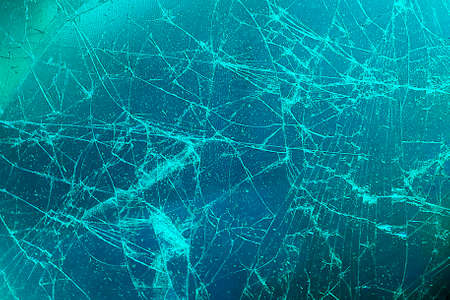 Broken glass display or cracked screen close-up. An empty, flat surface of a cold color.