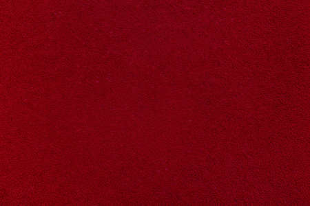 Textile background. Red velvet or corduroy. An empty and flat surface. Material for furniture. Stockfoto
