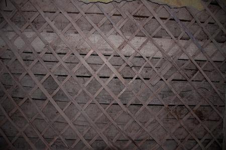 masonary: the old wooden building. crumbling plaster. wood veneer