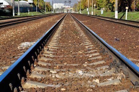 ,railroad tracks on a sunny day cloudy autumn blue sky photo