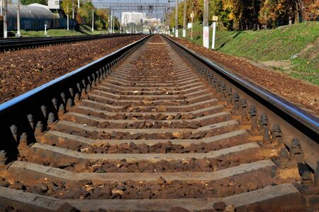 Rails,rails railway sleepers gravel green grass photo