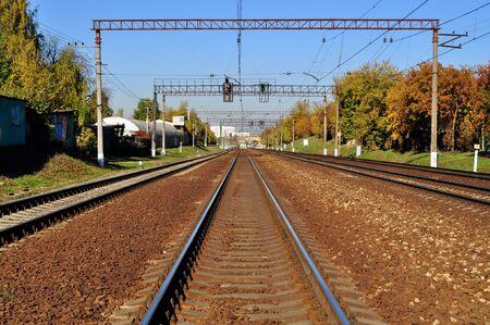 railroad rails way sleepers autumn blue sky photo