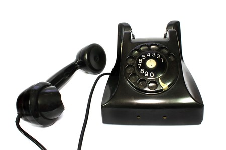 Old-fashioned black telephone receiver with cord on white background Stock Photo