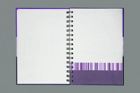 Purple gradient note book on gray photo