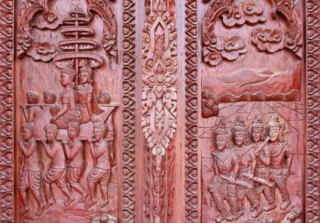 Old wooden door were carved Thai pattern Stock Photo - 8779678