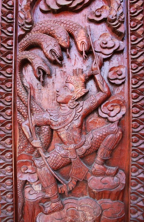 Old wooden door were carved Thai pattern Stock Photo - 8779645