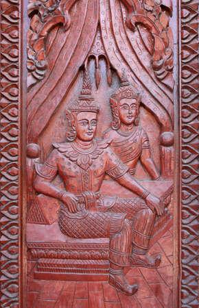 Old wooden door were carved Thai pattern photo