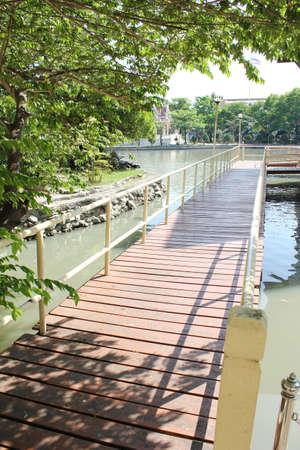 wooden bridge cross a river in a garden    Stock Photo - 8779576