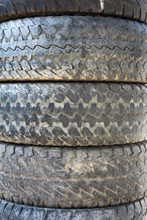 A stack of used tires in the garage     photo