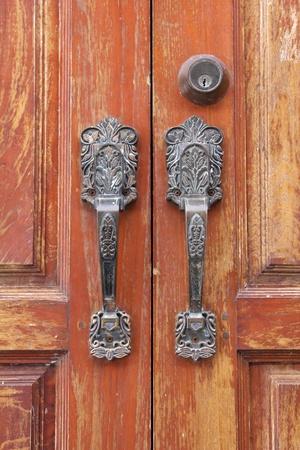 Vintage door handle on an grunge door  photo