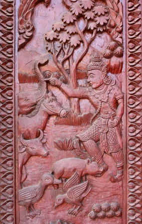 Old wooden door were carved Thai patter photo