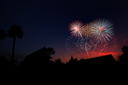countryside home with fire works  写真素材