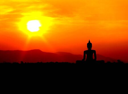 buddha silhouette  on mountain with sunset background photo