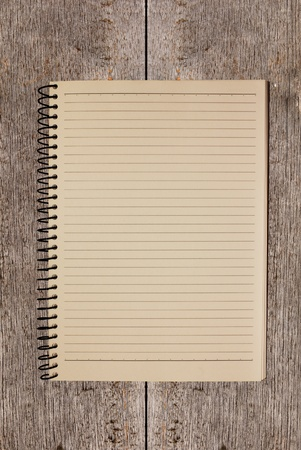 old note book on wooden background Stock Photo