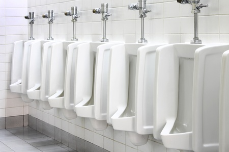 Urinals in public toilet photo