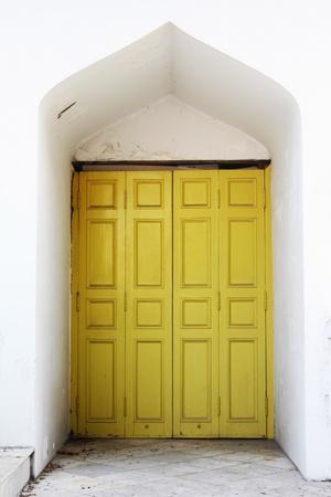 Yellow wooden door, vintage design Stock Photo - 9055520