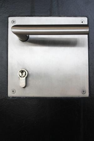 Doorknob at a black iron door photo