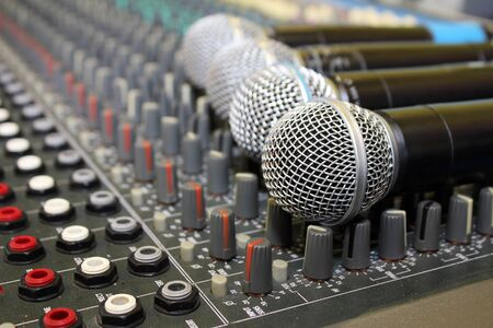 audio mixer: Sound mixing board during a musical performance at a fair  Stock Photo