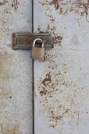 old metal lock on the grunge door  photo