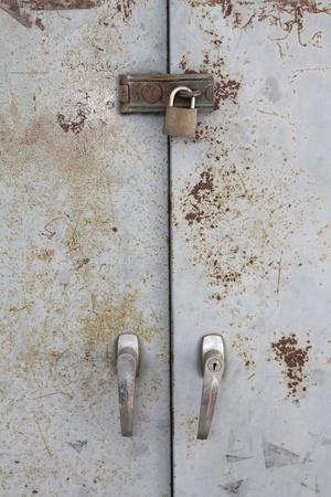 old metal lock on the grunge door  Stock Photo