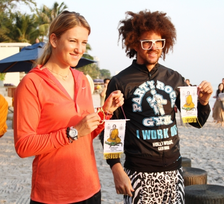HUA HIN, THAILAND - DEC 28:Victoria Azarenka(pink) of Belarus and Redfoo LMFAO show the ciphers at Intercontinental Hua hin resort on December 28, 2012 in Hua hin, Thailand.  Editorial